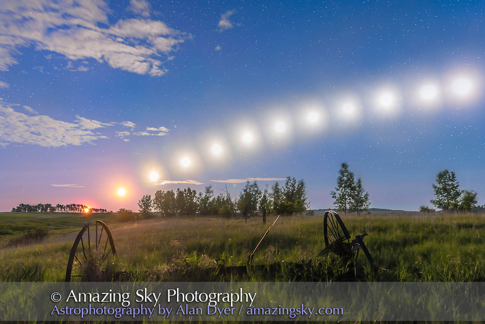 A composite stack of 12 images taken June 11/12, 2017 of the waning gibbous Moon tracking low across the southern sky on a June nght, from moonrise at left at 11:30 pm to when it began to leave the frame at right at 4 a.m. and when the sky was brightening with dawn. Images are at 25-minute intervals. The sky is blue here from the moonlight. <br /> <br /> This demonstrates how the summer Moon at and around Full phase tracks low across the south just as the Sun does during winter.<br /> <br /> The frames here were taken from an 1172-frame time-lapse, from home in southern Alberta, with the Nikon D750 and 24mm lens. While the sky comes from a stack of 12 images, the ground is from a stack of just two, to minimize the loss of shadows from the moving Moon. <br /> <br /> Exposures were 10 to 13 seconds, vastly overexposing the Moon but the sequence was intended first and foremost for a time-lapse where each frame has to be well-exposed to show the sky and ground, and not just the disk of the Moon in a dark underexposed scene.