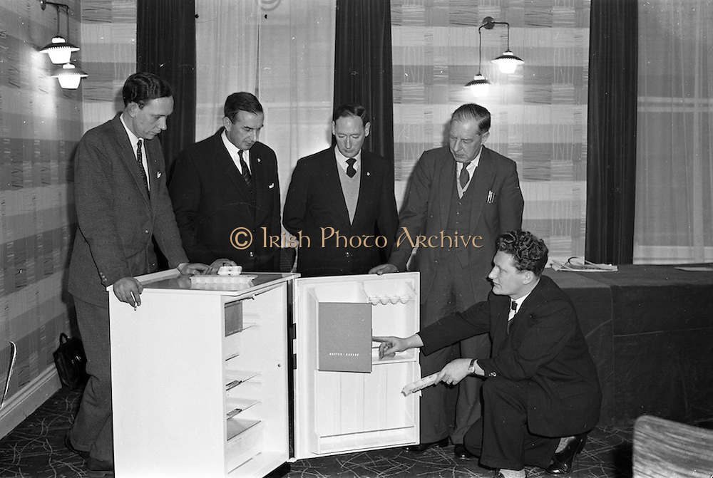 31/01/1962<br /> 01/31/1962<br /> 31 January 1962<br /> A.E.I. Gala Meetings for wholesalers in the Moira Hotel, Dublin. Pictured are: Des McStay, Southern Representative for A.E.I. - Gala, showing the new Gala Refrigerator to wholesale dealers (l-r) Victor Lowe, Manager, Electrical department, Dockrells; J.P. Murphy, General Manager, Baxendales; R. Kilbride, Manager, Electrical Department, Walkers Ltd. and E.J. Swinhorn, Manager, Electrical Department, Baxendales.