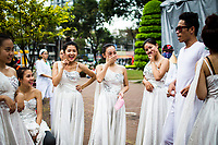 A group of young Vietnamese stand backstage during a streetside performance in downtown Ho Chi Minh City, Vietnam.