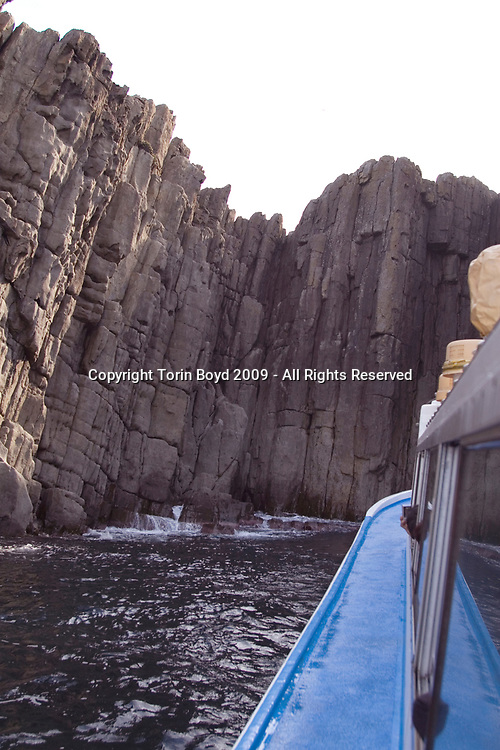 Nov. 26, 2009, Sakai City: This is the rocky cliffs of Tojinbo, a popular tourist attraction on the Japan Sea coast that's also known for the number of suicide deaths that occur here. This view shows the cliffs from a tour boat that gives cruises of the coastline. Located in Sakai City, Fukui Prefecture, this scenic area known for it's coastal beauty, seafood and onsen hot springs resorts now adds suicide as a reason to come here. In 2008 twenty suicides occurred here, but this figure varies between Sakai City officials and a suicide help group dedicated to preventing suicides here. Called Kokoro ni Hibiku Bunshu Henshukyoku, this NPO founded in 2004 by retired policeman Yukio Shige, who along with a group of volunteers patrols the cliffs on a daily basis to deter those contemplating jumping to their deaths. According to Shige, age 65, in the past five years since he founded his NPO, he is responsible for talking 222 people out of killing themselves. But even with Shige's efforts, the deaths here continue and as of late November, 2009, the current number of annual suicides at Tojinbo stands at thirteen. Japan has one of the highest suicide rates in the world and 2009 may surpass the record 34,427 deaths that occurred here in 2003. This increase is though to be a result of the Japanese recession which has been worsened by the global economic downturn. Depression is the number one cause for suicide in Japan, followed by illness and debt. Photo by Torin Boyd.