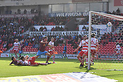 Scunthorpe United defender Murray Wallace (5) shoots at goal only to hit the bar tackled  by Doncaster Rovers defender Joe Wright (15)  during the EFL Sky Bet League 1 match between Doncaster Rovers and Scunthorpe United at the Keepmoat Stadium, Doncaster, England on 17 September 2017. Photo by Ian Lyall.