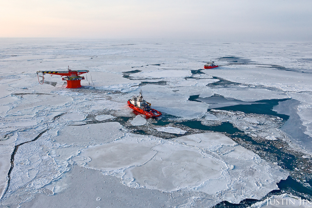 An aerial view of the world's most northerly oil terminal (according to the Guiness Book of Records). The LUKoil terminal, off Russia's Arctic shore, serves tankers using the Arctic route between Europe and Asia, and is another step in Russia's push towards the North Pole. The two boats are ice-breakers working round-the-clock.