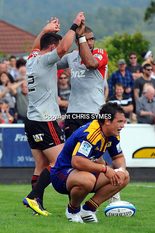 Crusaders Patrick Osborne celebrates with Ryan Crotty after he scores a second try during their Super Rugby Pre-season game Crusaders v Highlanders. Rugby Park, Greymouth, New Zealand. Friday 3 February 2012. Photo: Chris Symes/www.photosport.co.nz