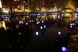 November 13, 2016 - Paris, France - Floating lanterns are placed on the Canal St Martin as France commemorates one year since the Paris terrorist attacks on November 13, 2016 in Paris, France. France pay tributes to the victims of the 2015 Paris terrorists attacks which left at least 130 dead and many others injured by gunmen and suicide bombers from the Islamic State. (Credit Image: © Mehdi Taamallah/NurPhoto via ZUMA Press)
