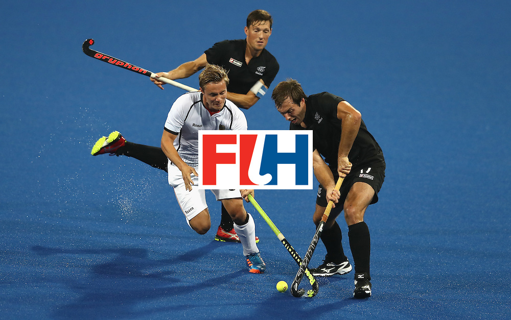 RIO DE JANEIRO, BRAZIL - AUGUST 14:  Matts Grambusch of Germany is tackled by Nic Woods during the Men's hockey quarter final match between the Germany and New Zealand on Day 9 of the Rio 2016 Olympic Games at the Olympic Hockey Centre on August 14, 2016 in Rio de Janeiro, Brazil.  (Photo by David Rogers/Getty Images)