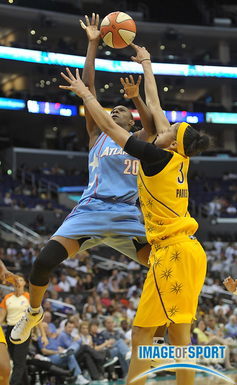 May 30, 2010; Los Angeles, CA, USA; Atlanta Dream forward Sancho Lyttle (20) is defended by Los Angeles Sparks forward Candace Parker (3) in the second half at the Staples Center. The Dream defeated the Sparks 101-82.