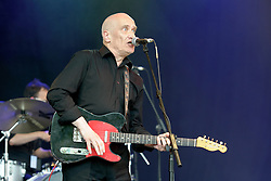 Wilko Johnson performs at Cornbury Music Festival in front of a sun soaked crowd. Wilko Johnson (born John Peter Wilkinson, 12 July 1947) was particularly associated with the rhythm and blues band Dr. Feelgood in the 1970s. Johnson and Dr Feelgood have been credited as one of the founding influences of the English punk movement. Wilko Johnson was diagnosed with terminal Pancreatic cancer in 2012. Sunday 7th July, 2013, Photo by: i-Images.