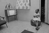 1973, Ibadan, Nigeria --- Girl Watching Television --- Image by © Owen Franken