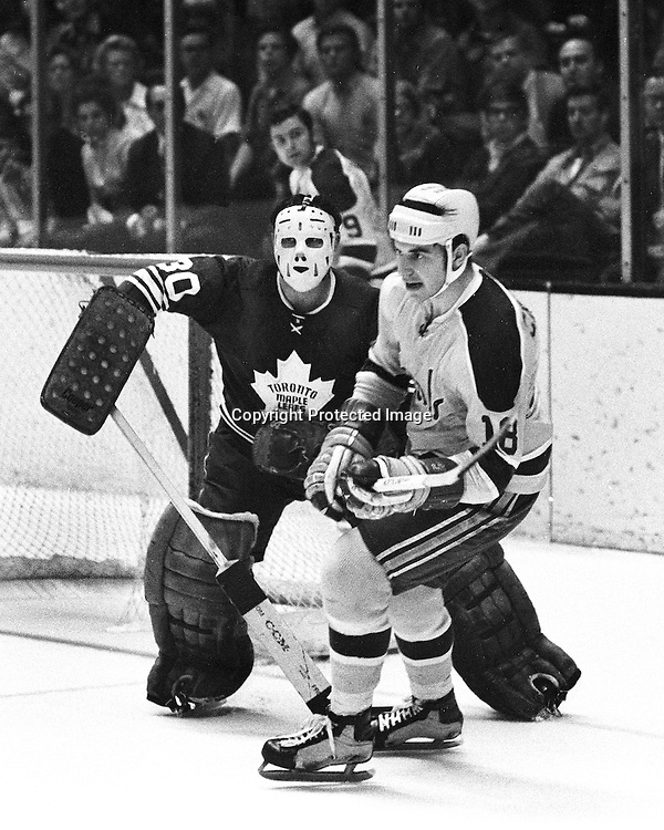 Toronto  Maple Leaf goalie Bruce Gamble guards the net , Seals Gary Croteau scates by .(photo Nov 7, 1970 by Ron Riesterer)