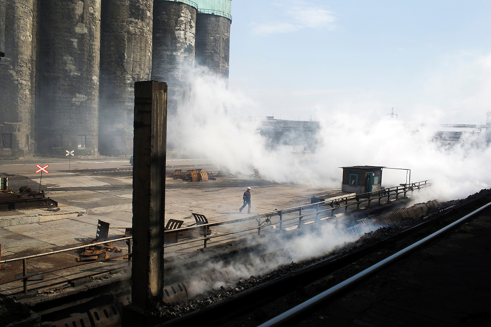 A worker is seen at the Metinvest Coke Plant on March 18, 2015 in Avdiivka, Ukraine. Shells have hit the property of the plant over 150 times, including multiple hits on the plant itself.