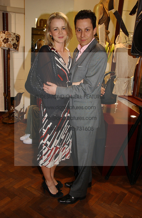 NICK GOLD and SOPHIE MICHELLE at a party to celebrate the opening of the new fashion store Jezebell at 59 Blandford Street, London W1 on 20th April 2006.<br />