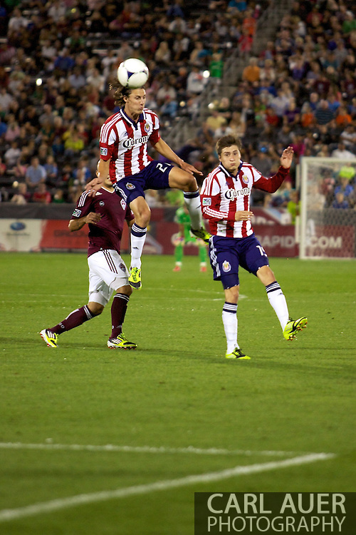 August 18th, 2012: Chivas USA teammates Ben Zemanski (21) and Jorge Villafana (19) go airborne for a ball in the second half of their game against the Colorado Rapids at Dick's Sporting Goods Park