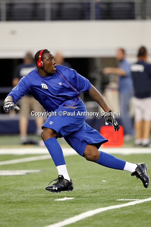 New York Giants defensive end Jason Pierre-Paul (90) goes out for a pass while warming up before the NFL week 7 football game against the Dallas Cowboys on Monday, October 25, 2010 in Arlington, Texas. The Giants won the game 41-35. (©Paul Anthony Spinelli)