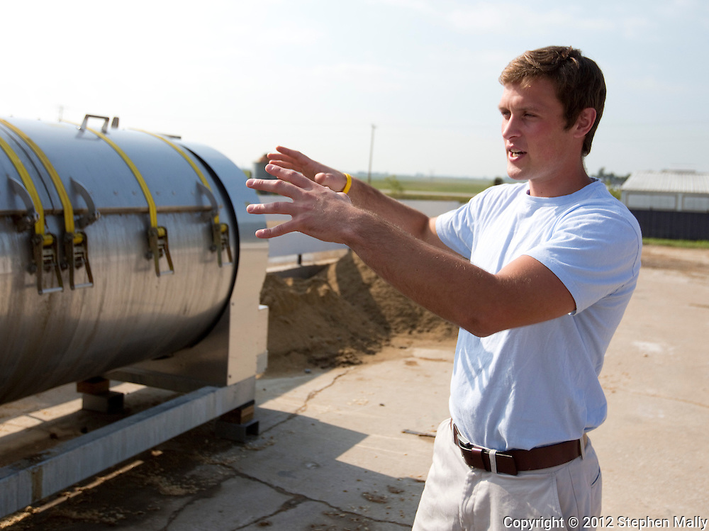 Ben Dittmer talks about one of their Biovator composters at Grandview Farms in Eldridge, Iowa on Thursday August 9, 2012.