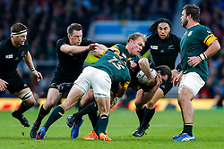 New Zealand Outside Centre Conrad Smith is tackled by South Africa Flanker Schalk Burger and Outside Centre Jesse Kriel - Mandatory byline: Rogan Thomson/JMP - 07966 386802 - 24/10/2015 - RUGBY UNION - Twickenham Stadium - London, England - South Africa v Wales - Rugby World Cup 2015 Semi Finals.