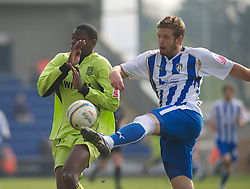 COLCHESTER, ENGLAND - Saturday, April 24, 2010: Tranmere Rovers' Bas Savage and Colchester United's Paul Reid in action during the Football League One match at the Western Community Stadium. (Photo by Gareth Davies/Propaganda)