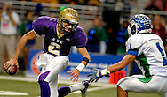 25 Nov. 2011 -- ST. LOUIS -- CBC High School quarterback Dalton Demos (2) scrambles under pressure from Blue Springs South High School defender Patrick Martin Jr. (1) during the MSHSAA Class 6 state championship Friday, Nov. 25, 2011 at the Edward Jones Dome in St. Louis. Photo © copyright 2011 Sid Hastings.