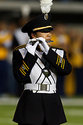 BERKELEY, CA - OCTOBER 06:  A member of the California Golden Bears band performs on the field before the game against the UCLA Bruins at California Memorial Stadium on October 6, 2012 in Berkeley, California. The California Golden Bears defeated the UCLA Bruins 43-17. (Photo by Jason O. Watson/Getty Images) *** Local Caption ***