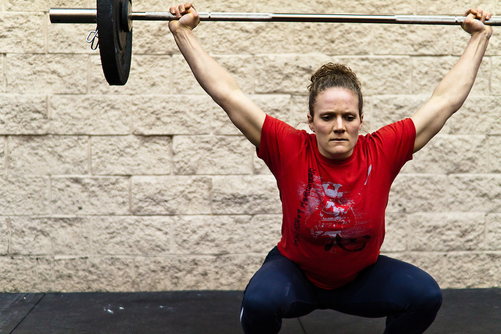 Quinn Megargel does a snatch during a WOD, Crossfit image, picture, photo, photography of health, elite, exercise, training, workouts, WODs, taken at Progressive Fitness CrossFit,Colorado Springs, Colorado, USA.