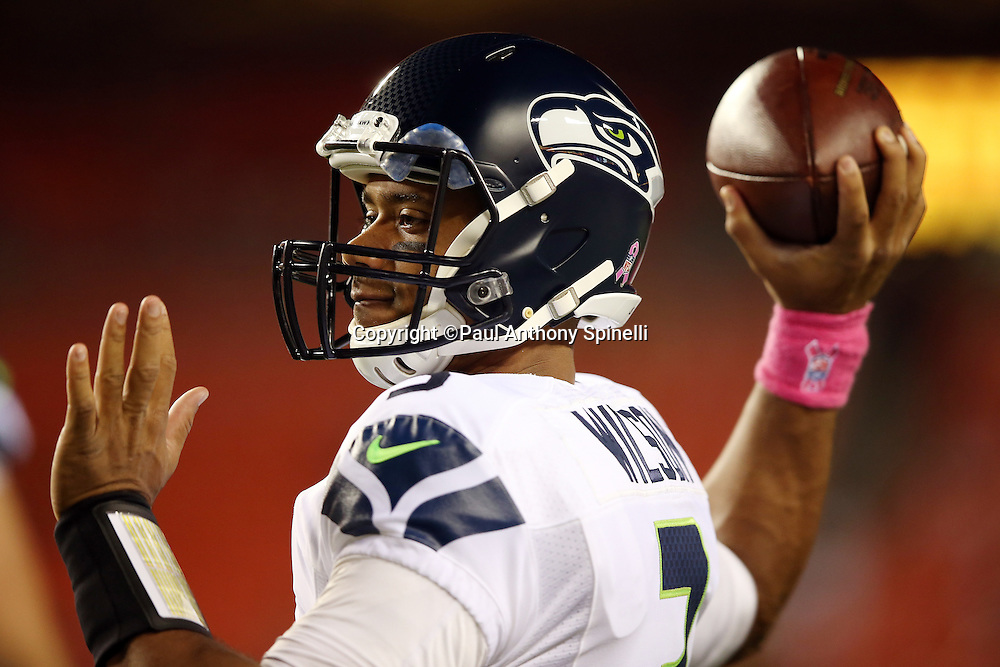 Seattle Seahawks quarterback Russell Wilson (3) throws a pass as he warms up before the NFL week 5 regular season football game against the Washington Redskins on Monday, Oct. 6, 2014 in Landover, Md. The Seahawks won the game 27-17. ©Paul Anthony Spinelli