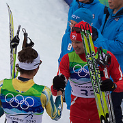 Winter Olympics, Vancouver, 2010.Dario Cologna, Switzerland,winning Gold is congratulated by Ben Sim, Australia,  after the Men's 15km Cross Country Skiing event at The Whistler Olympic Park, Whistler, during the Vancouver Winter Olympics. 14th February 2010. Photo Tim Clayton