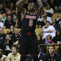 Guard Terry Rozier shoots during an NCAA basketball game between the 14th ranked Louisville Cardinals and the UCF Knights at the CFE Arena on Tuesday, December 31, 2013 in Orlando, Florida. (AP Photo/Alex Menendez)