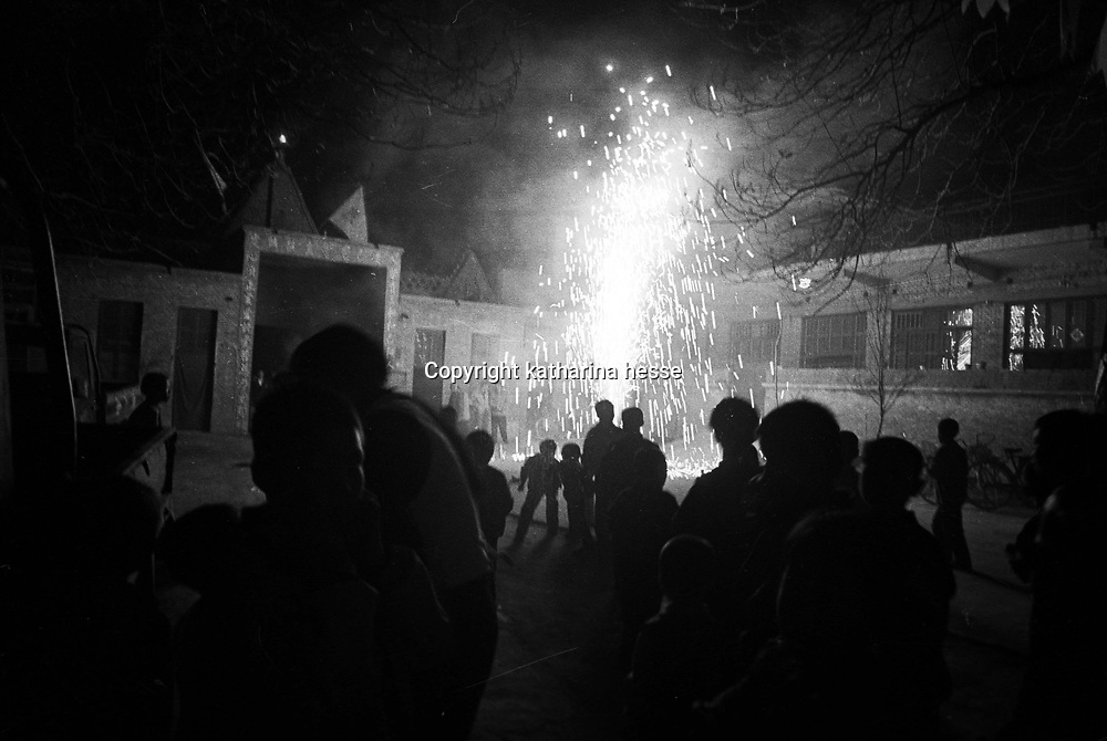 BIAN VILLAGE, 14 APRIL 2001:a catholic church congregation lits a firework after the Saturday easter mass. China cut relations with the Vatican in the early fifites and since then, established a Patriotic catholic Church that's controlled by Chinese authorities.<br />