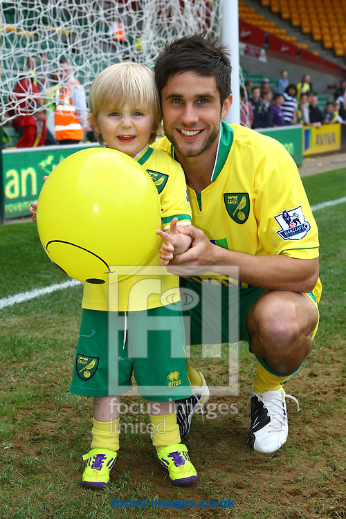 Picture by Paul Chesterton/Focus Images Ltd.  07904 640267.13/05/12.Adam Drury of Norwich and his child after the Barclays Premier League match at Carrow Road Stadium, Norwich.
