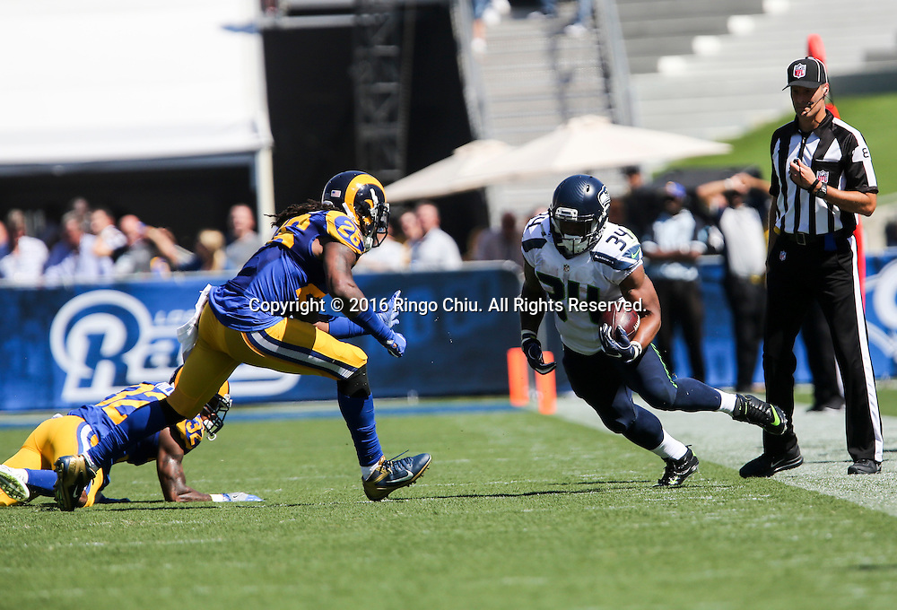 Seattle Seahawks running back Thomas Rawls (34) is defended by Los Angeles Rams Mark Barron (26)  during a NFL football game, Sunday, Sept. 18, 2016, in Los Angeles. The Rams won 9-3.(Photo by Ringo Chiu/PHOTOFORMULA.com)<br /> <br /> Usage Notes: This content is intended for editorial use only. For other uses, additional clearances may be required.