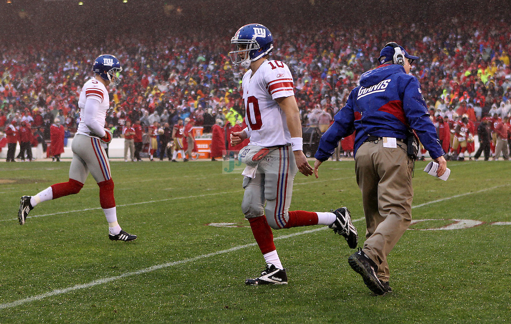 Head coach Tom Coughlin of the New York Giants looks with  Eli Manning #10 on against the San Francisco 49ers during the NFC championship game at Candlestick Park in San Francisco, California, USA 22 Jan 2012..The Giants defeated the 49ers 20-17.The Giants defeated the 49ers 20-17. (Photo by Jed Jacobsohn)...