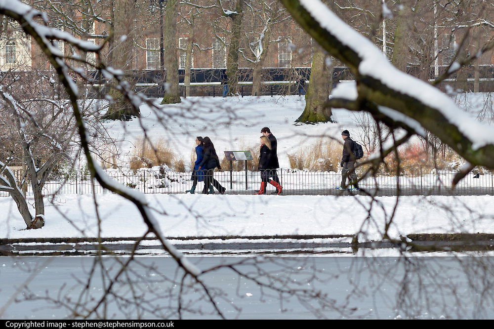 © Licensed to London News Pictures. 21/01/2013. Westminster, UK People walk around the lake. Snow in the Royal Park, St James Park, in Central London today 21 January 2013. Photo credit : Stephen Simpson/LNP