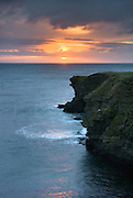 Sunset from Skipi Geo looking towards Brough Head, Mainland Orkney Islands Scotland