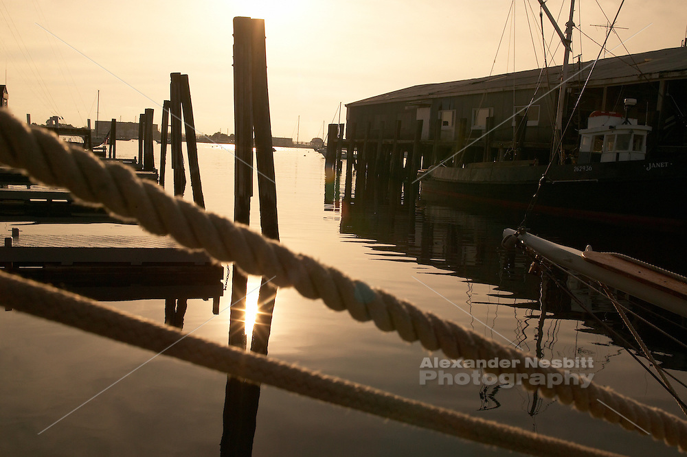 USA, Newport, RI - Dock lines cross a view of a calm april evening on Bannister's wharf