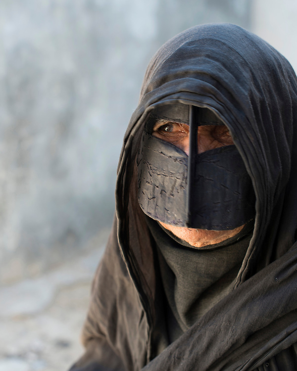 Portrait of a Bandari woman wearing a traditional mask called burqa