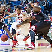 MOBILE, AL - DECEMBER 29:  Freddie Goldstein #11 of the South Alabama Jaguars attempts to maneuver between Cameron Golden #0 and Kendrick Washington #40 of the Arkansas State Red Wolves at USA Mitchell Center on December 29, 2012 in Mobile, Alabama. Arkansas State defeated South Alabama 63-54. (Photo by Michael Chang/Getty Images) *** Local Caption *** Freddie Goldstein;Cameron Golden;Kendrick Washington