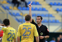 Ivan Knezovic of Domzale gets red card from referee Miran Bukovec at 26th Round of Slovenian First League football match between NK Domzale and NK Rudar Velenje in Sports park Domzale, on April 4, 2009, in Domzale, Slovenia. (Photo by Vid Ponikvar / Sportida)