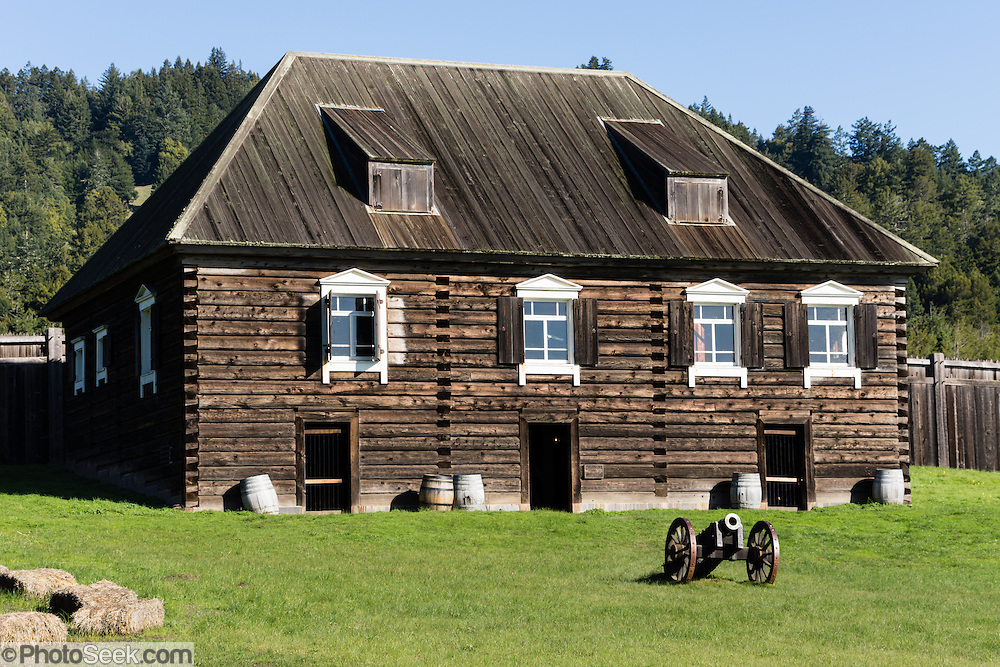 "Kuskov House is the reconstructed residence of the founder and first manager of Fort Ross. Living quarters are upstairs above an armory. Fort Ross State Historic Park preserves a former Russian colony (1812-1842) on the west coast of North America, in what is now Sonoma County, California, USA. The 5.5-inch howitzer cannons are historical reproductions. Visit Fort Ross and dramatic coastal scenery 11 miles north of Jenner on California Highway One.  Initially, sea otter pelts funded Russian expansion, but by 1820, overhunting motivated the Russian-American Company to introduce moratoriums on hunting seals and otters, the first marine-mammal conservation laws in the Pacific. Russian voyages greatly expanded California's scientific knowledge. For centuries before Europeans arrived, this site was called Metini and had been occupied by the Kashaya band of Pomo people who wove intricate baskets and harvested sea life, plants, acorns, deer, and small mammals. Sponsored by the Russian Empire, ""Settlement Ross"" was multicultural, built mostly by Alaskan Alutiiq natives and occupied mostly by native Siberians, Alaskans, Hawaiians, Californians, and mixed Europeans. Renamed ""Ross"" in 1812 in honor of Imperial Russian (Rossiia), Fortress Ross was intended to grow wheat and other crops to feed Russians living in Alaska, but after 30 years was found to be unsustainable. Fort Ross was sold to John Sutter in 1841, and his trusted assistant John Bidwell transported its hardware and animals to Sutter's Fort in the Sacramento Valley. Fort Ross is a landmark in European imperialism, which brought Spanish expanding west across the Atlantic Ocean and Russians spreading east across Siberia and the Pacific Ocean. In the early 1800s, Russians coming from the north met Spanish coming from the south along the Pacific Coast of California, followed by the USA arriving from the east in 1846 for the Mexican-American War. Today, Fort Ross is a California Historical Landmark and a National Histori"
