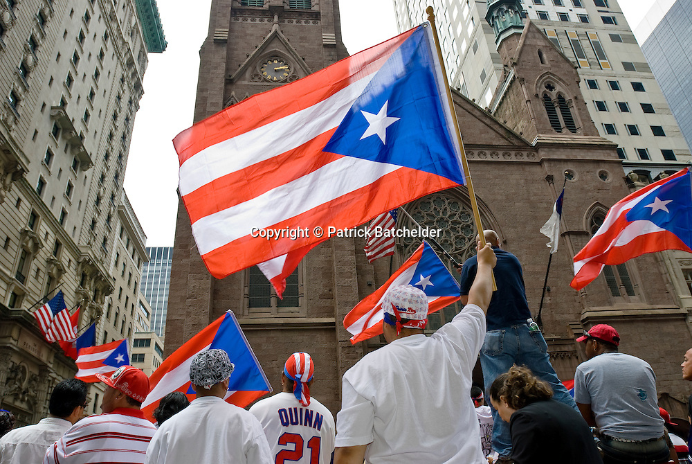 People show their pride with flags during the Puerto Rican Day Parade, held every June on Fifth Avenue in Manhattan, New York City.