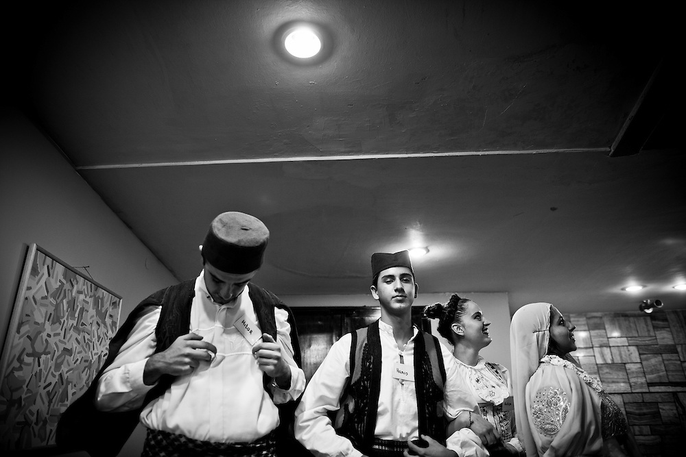 Novi Pazar, Sandzak, Serbia. A group of young people wearing traditional dress during a folk performance within the cultural centre in town...In south Serbia, near the Kosovo borders, muslim serbs or also called ?Bosniaks? are living in the Sandzak, a community that Belgrade has always looked and continues to look with suspicion, fearing to outbreak in a new Secessionist fire..Antique Mall of traffic on the road between the west and Baghdad, the capital of Novi Pazar, 100 thousand inhabitants, according to international statistics .is the second ?youngest? city of the Balkans. Lives in the balance between unemployment and hope, modernity and tradition: young dressed with trendy European style mingle in the streets with girls and women who wear the traditional islamic veil. Territorially divided between Serbia and Montenegro, with six provinces under the government in Belgrade and Podgorica is the scene not only of ethnic conflict between Serbs and ?Bosniaks? but also to rivalries and jealousies within the Islamic community.