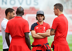 STOKE-ON-TRENT, ENGLAND - Sunday, August 9, 2015: Liverpool's Lazar Markovic chats with Mamadou Sakho, Dejan Lovren and former player Stoke City's Glen Johnson before the Premier League match at the Britannia Stadium. (Pic by David Rawcliffe/Propaganda)