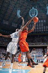 10 January 2010: Virginia Tech forward Jeff Allen (00) is pressured by Tar Heels forward Ed Davis (32) during a 78-64 North Carolina Tar Heels win at the Dean E. Smith Center in Chapel Hill, NC.
