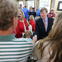 Lieutenant Governor Tate Reeves shakes hands with Todd Jordan during a campaign stop for his run for Govenor on Tuesday morning at Papa V's in Tupelo.
