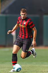 July 16, 2011; San Francisco, CA, USA;  Manchester City forward Edin Dzeko (10) dribbles the ball against Club America during the first half at AT&T Park. Manchester City defeated Club America 2-0.