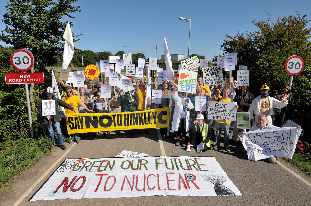 © Licensed to London News Pictures. 28/07/2016. Hinkley Point, Somerset, UK.  A final investment decision is expected today from French energy company EDF to go ahead with the building of Hinkley C nuclear power plant, the first nuclear power plant to be built in the UK for 20 years, which will be built next to the existing Hinkley A and B nuclear plants. FILE PICTURE dated 12 September 2010; Protest at the gates of Hinkley Point Nuclear Power station in Somerset, against the proposed building of a 3rd nuclear reactor, Hinkley C. Photo credit : Simon Chapman/LNP