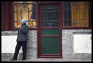 A Chinese woman eats toast outside in Wu Tai Xian.