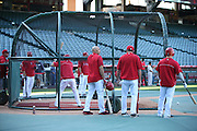 ANAHEIM, CA - APRIL 15:  Raul Ibanez (center) #28 of the Los Angeles Angels of Anaheim looks on during batting practice before the game against the Oakland Athletics at Angel Stadium on Tuesday, April 15, 2014 in Anaheim, California. The Athletics won the game 10-9 in eleven innings. (Photo by Paul Spinelli/MLB Photos via Getty Images) *** Local Caption *** Raul Ibanez