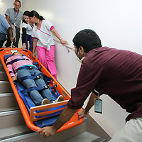Coachella Valley High School junior Maria Anaya, 16, of Thermal is evacuated from a second story room through a stairwell by RNs Brijesh Patel (right), Binal Patel (pink pants), Brittany Rutherford (blue pants), and Chuck Greene (top) during The Great California Shake Out on Thursday, October 15, 2009 at JFK Memorial Hospital in Indio. In the scenario, the hospital had to evacuate victims from the only second story tower building on their campus without using an elevator. Crystal Chatham, The Desert Sun