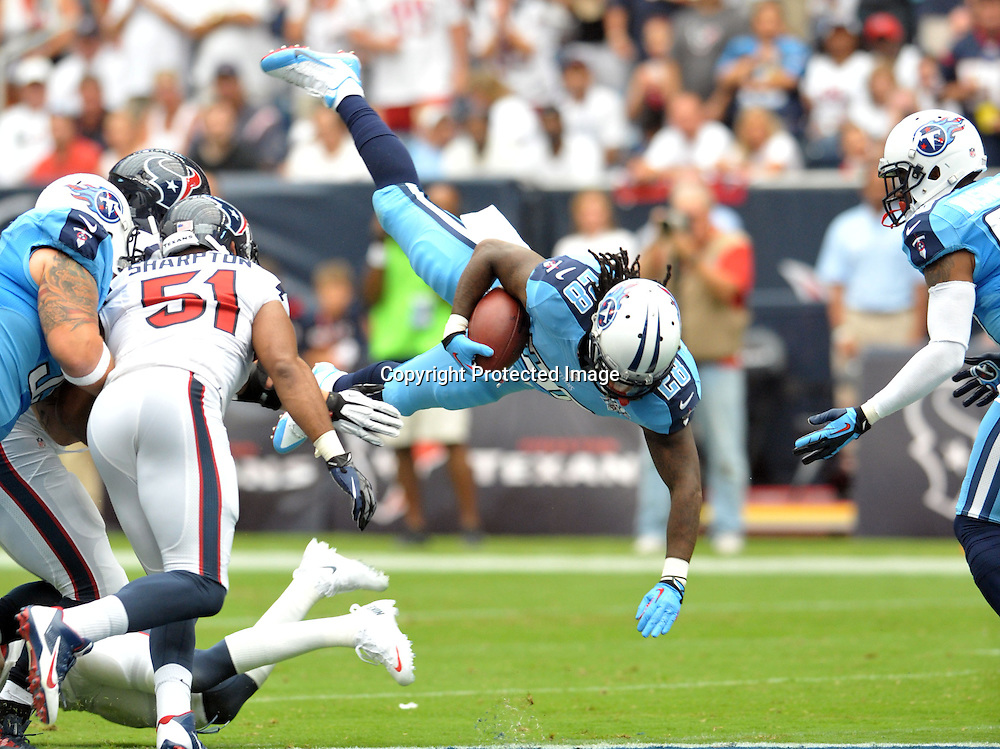 September 15 2013: Titans RB Chris Johnson gets tripped up during 30 - 24 loss to the Texans at Reliant Stadium in Houston, TX.