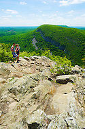 Hikers looking across to Mount Minsi from the Indian Head lookout on Mount Tammany, New Jersey.