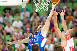 Milan Macvan of Serbia vs Damir Markota of Croatia during friendly basketball match between National teams of Croatia and Serbia for first place at Adecco Ex-Yu Cup 2011 as part of exhibition games before European Championship Lithuania 2011, on August 9, 2011, in Arena Stozice, Ljubljana, Slovenia. (Photo by Vid Ponikvar / Sportida)